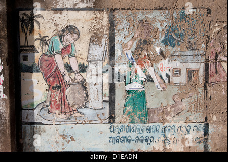 Peeling painted wall depicting women collecting water from the pump on village walls, Raghurajpur, Orissa, India, - Stock Photo