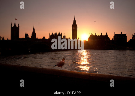 Sunset over Westminster Bridge, Houses of Parliament and Big Ben, London, England, United Kingdom, Europe - Stock Photo