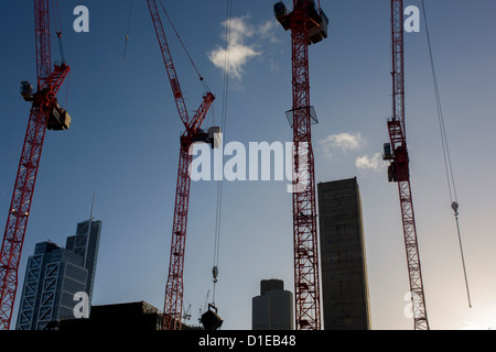 Cranes and blue sky on a large construction site at Broadgate development in the City of London. Looking up from - Stock Photo