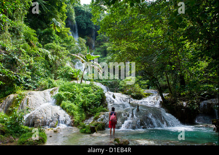 Woman looking at the beautiful Mele-Maat cascades in Port Vila, Island of Efate, Vanuatu, South Pacific, Pacific - Stock Photo