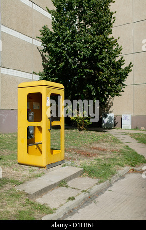 Magdeburg, Germany, a phone booth with missing panes in New Olvenstedt - Stock Photo
