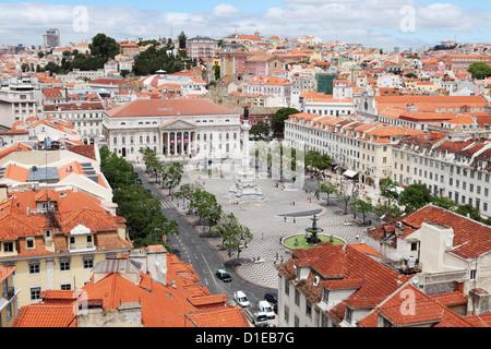 Rossio square (Praca Dom Pedro IV) in the Baixa district centre of Lisbon, Portugal, Europe - Stock Photo
