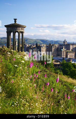 Dugald Stewart Monument and view of Old Town from Calton Hill in summer sunshine, Edinburgh, Scotland, United Kingdom, - Stock Photo