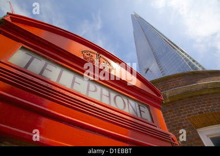 Red telephone box and The Shard, London, England, United Kingdom, Europe - Stock Photo