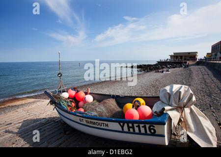 Fishing boat on the shingle beach at Sheringham, Norfolk, England, United Kingdom, Europe - Stock Photo
