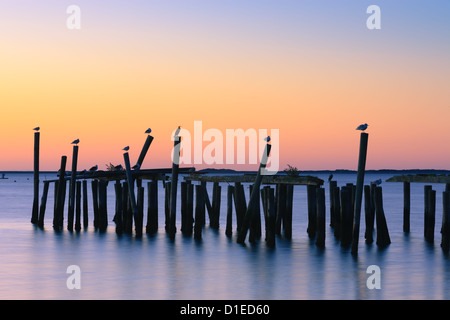 Sunrise over the old jety in Provincetown on the north of Cape Cod, Massachusetts - Stock Photo