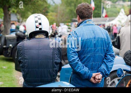 Two men standing in the paddock next to a vintage Bugatti racing car at Prescott, Gloucestershire, England, UK. - Stock Photo