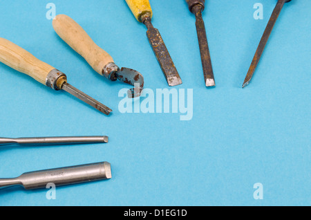 chisel graver carve tools collection for wood work on blue background. place for text. - Stock Photo