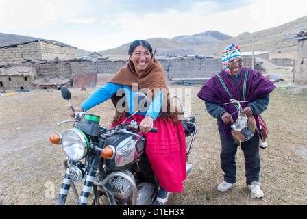 Aymara biker in the Cordillera Real - Stock Photo