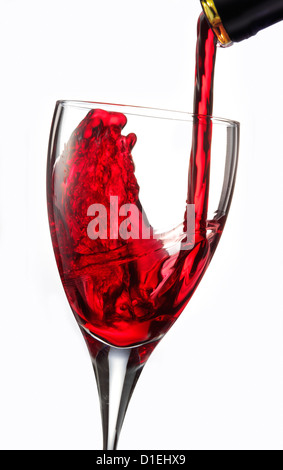 Red wine being poured into a glass - Stock Photo
