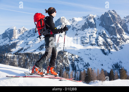 Young woman ski mountaineering at the Gosaukamm, Tennengau, Austria - Stock Photo