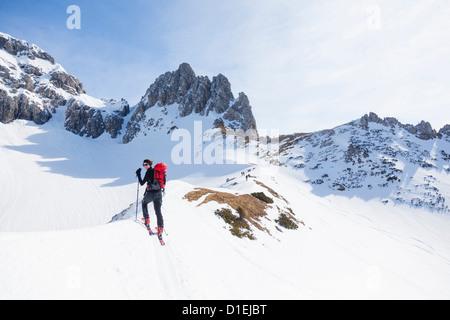 Young woman ski mountaineering at the Gosaukamm, Tennengau, Austria - Stock Photo