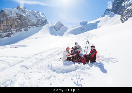 Ski mountaineers having a break at the Watzmann, Berchtesgaden Alps - Stock Photo