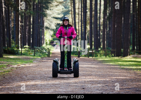 Riding a Segway at Sherwood Pines Forest Park, Nottinghamshire - Stock Photo