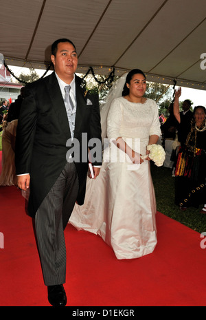 The Crown Prince of Tonga and his bride, Princess Sinaitakala ,walk up the red carpet as they arrive at their Wedding - Stock Photo