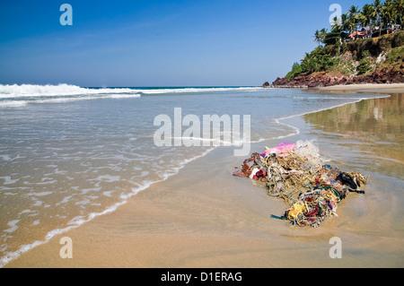Horizontal view of non biodegradable rubbish washed up on Papanasam beach at Varkala, Kerala. - Stock Photo