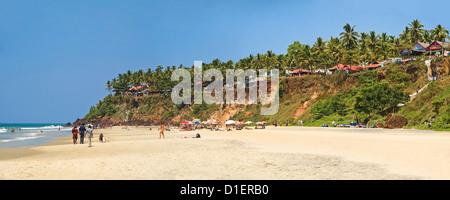 Horizontal panoramic (3 picture stitch) view along Papanasam beach at Varkala, Kerala. - Stock Photo