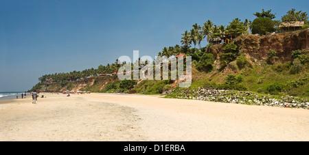 Horizontal panoramic (2 picture stitch) view along Papanasam beach at Varkala, Kerala. - Stock Photo