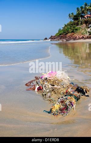Vertical view of non biodegradable rubbish washed up on Papanasam beach at Varkala, Kerala. - Stock Photo