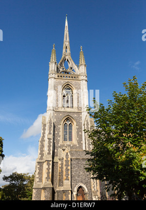 Old and unique church tower in Faversham Kent with crown spire on top - Stock Photo