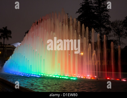 Illuminated fountains at dusk in Magic Water Tour / Circuit in Reserve Park, Lima, Peru - Stock Photo