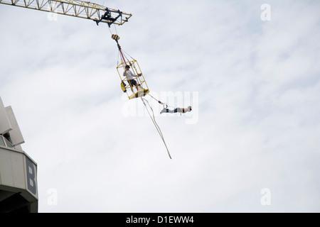 Bungee jumping from the pier in Scheveningen, Netherlands - Stock Photo