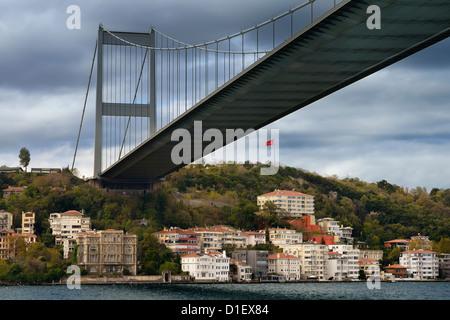 Fatih Sultan Mehmet Bridge over mansions on the Bosphorus Strait at Rumeli Hisari Istanbul Turkey - Stock Photo