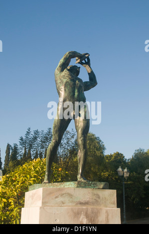 Statue of Discus Thrower in front of the Kalimarmaro Olympic Stadium Athens, Greece - Stock Photo