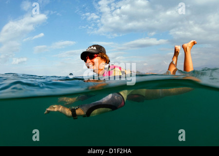 Woman swimming in the Dead Sea, Israel - Stock Photo