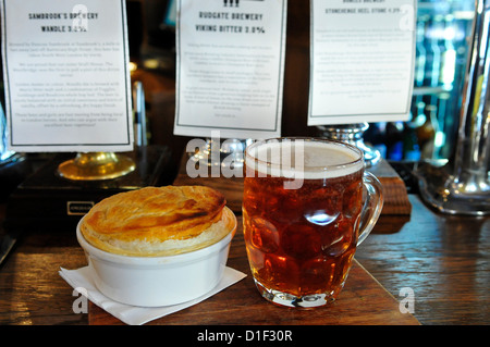 Pint of Ale and a Pie at The Draft House Pub, Northcote Road, Clapham, London, England, SW11 - Stock Photo