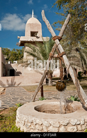 Historic well and mosque in an open-air museum, Abu Dhabi - Stock Photo