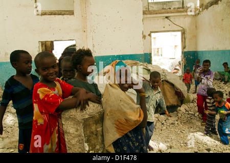Civil War ravaged buildings and refugee children Mogadishu Somalia - Stock Photo