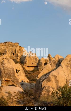 caves and rock formations at Goreme, Cappadocia, Anatolia, Turkey - Stock Photo