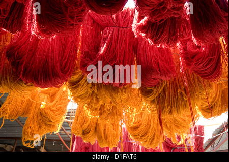 Brightly coloured wool hanging to dry in the dyers souk, Marrakech, Morocco, North Africa, Africa - Stock Photo