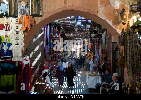 The view through an arch of shoppers in the souk in Marrakech, Morocco, North Africa, Africa - Stock Photo