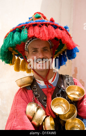 A water seller dressed in traditional Berber dress in Marrakech, Morocco, North Africa, Africa - Stock Photo
