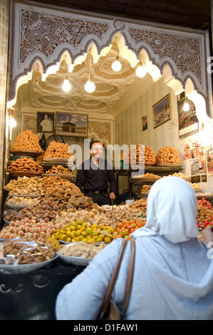 Nuts and dried fruit for sale at a stall in the souk in Marrakech, Morocco, North Africa, Africa - Stock Photo