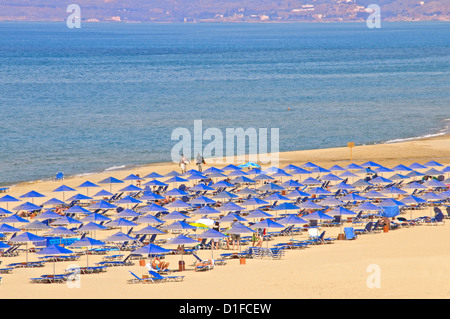 Beach and sunshades on beach at Giorgioupolis, Crete, Greek Islands, Greece, Europe - Stock Photo