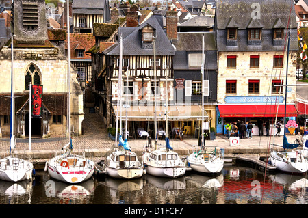 The Vieux Bassin, Saint Etienne church on the left, and boats moored along the quay, Honfleur, Calvados, Normandy, - Stock Photo