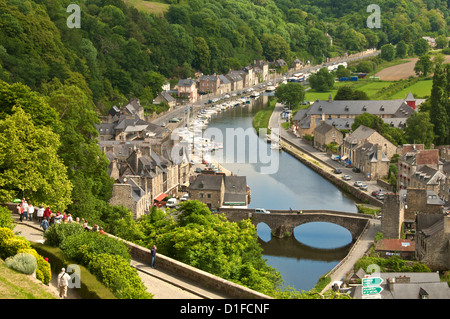 Boats and houses along the Banks of the River Rance, with the Old Stone bridge, Dinan, Cotes d'Armor, Brittany, - Stock Photo