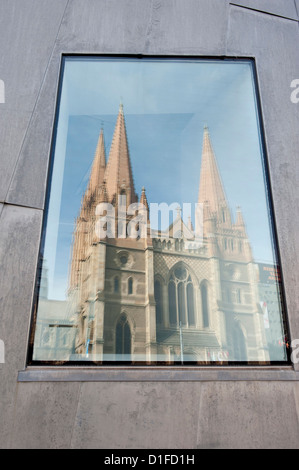 Reflection in window of St. Pauls Cathedral, Melbourne, Victoria, Australia, Pacific - Stock Photo