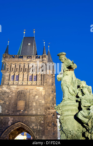Gothic Old Town Bridge Tower and statue of St. Ivo (Bishop of Chartres) at twilight, Old Town, Prague, Czech Republic, - Stock Photo