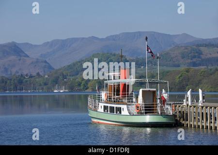 A tourist lake steamer awaits passengers at Pooley Bridge pier, Lake Ullswater, Lake District National Park, Cumbria, - Stock Photo