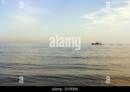 Boat ploughing Black Sea, Crimea, Ukraine - Stock Photo