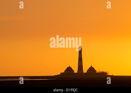 Lighthouse Westerheversand at sunset, Westerhever, North Frisia, Schleswig-Holstein, Germany - Stock Photo