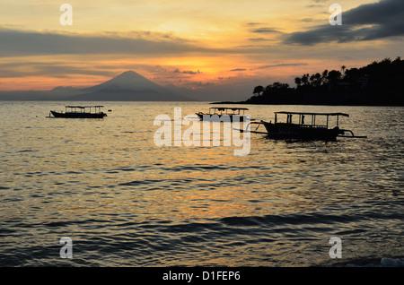Sunset at Senggigi Beach, with Bali's Gunung Agung in the background, Senggigi, Lombok, Indonesia, Southeast Asia, - Stock Photo