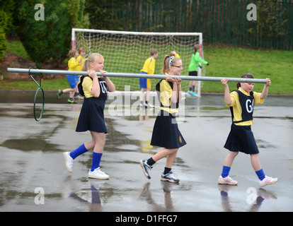 Schoolchildren carrying a netball goal at Our Lady & St. Werburgh's Catholic Primary School in Newcastle-under-Lyme, - Stock Photo