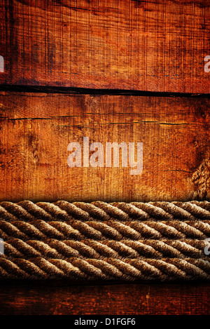 Beautiful brown wood texture with heavy ropes, image can be used as a background for your design. - Stock Photo