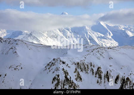 Ski resort and the mountains of Zell am See, Austrian Alps at winter - Stock Photo