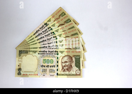 Indian currency A fan of five hundred rupee notes in white background 500 - Stock Photo